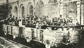 A Wikiwander through Tunnels, Mines, and Flames. A picture of a group of men in stovepipe hats making the first ever London Underground journey at Edgware Road in 1862